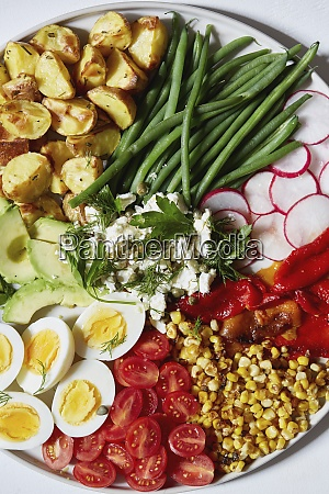 colorful vegetables salad and eggs on
