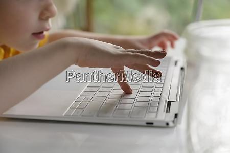 boy 4 5 using laptop