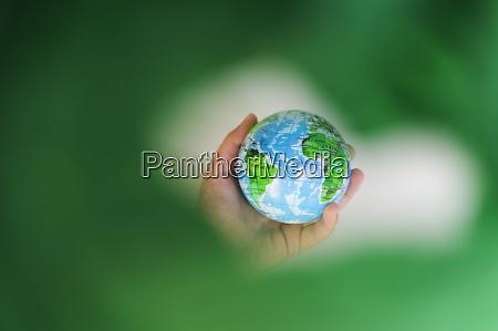 girls 6 7 hand holding globe