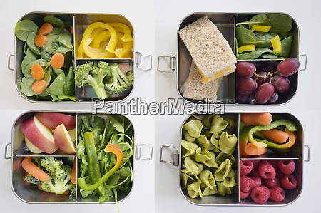 lunch boxes with fresh vegetables and