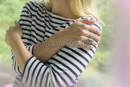 close up of blond woman hugging
