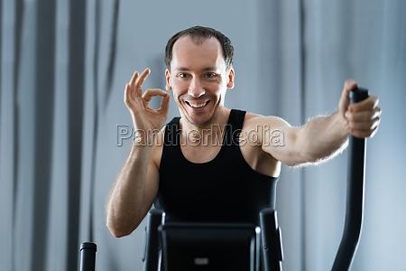 man training on elliptical trainer