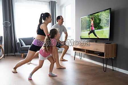 fit family doing home online stretching