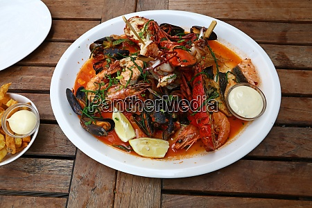 grilled seafood platter on wooden table