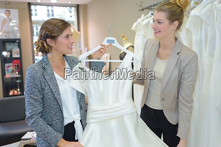 women in wedding dress store