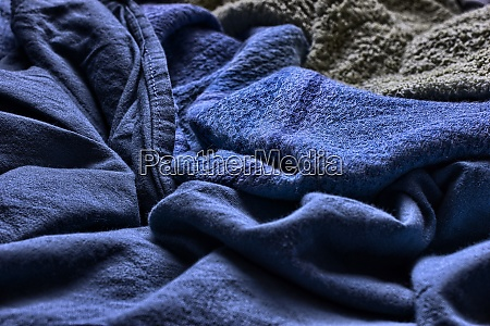 closeup of a messy blue blanket