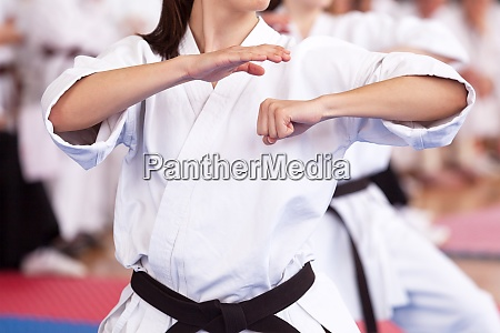 female karate practitioner body position during