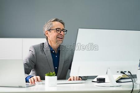happy professional man employee using computer
