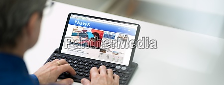 online newspaper on tablet computer