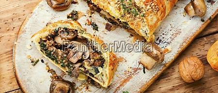 sliced pie with mushrooms