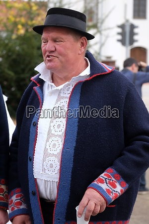 man dressed in folk costumes go