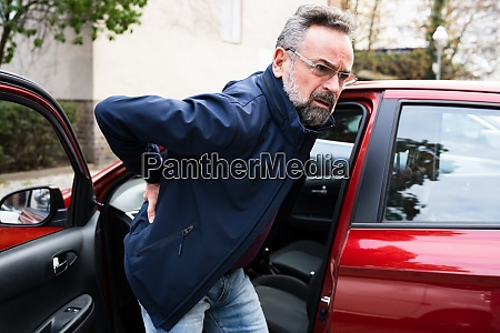 back pain car driving injury