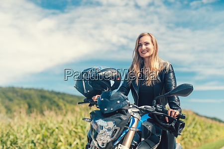 beautiful woman on a motorcycle looking
