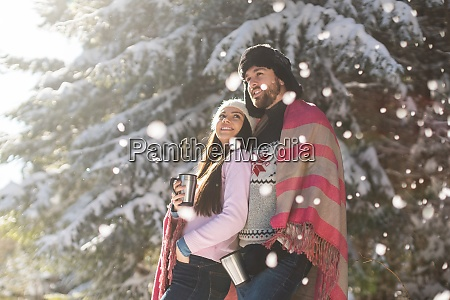 couple posing snowfall