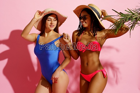 glamour ladies in swimsuits poses in