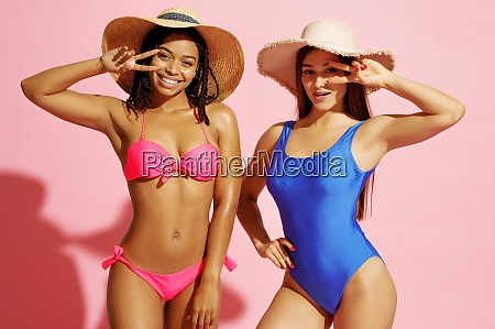 glamour women in swimsuits and hats