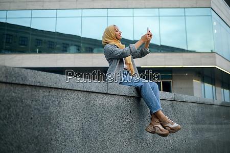 arab girl makes selfie at the