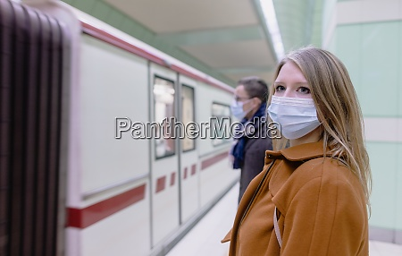 people in public transport wearing mask