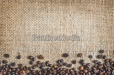 roasted coffee beans burlap canvas background