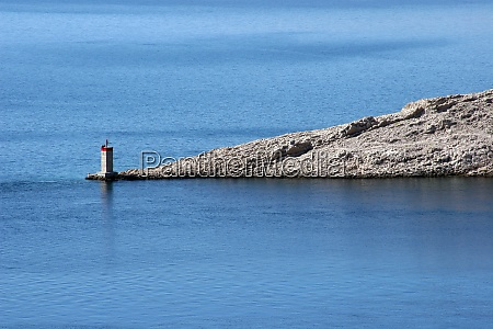 lighthouse and the ruins of the