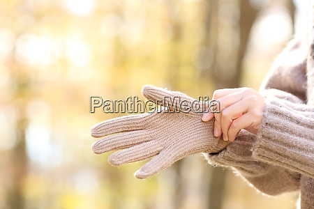 woman hands putting wool gloves in