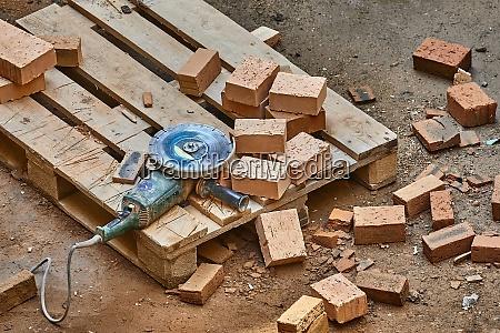 brick house construction cutting bricks