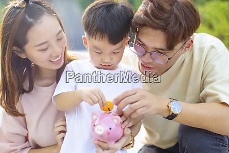happy parent help son putting a