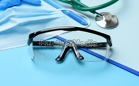 protective plastic glasses and disposable masks