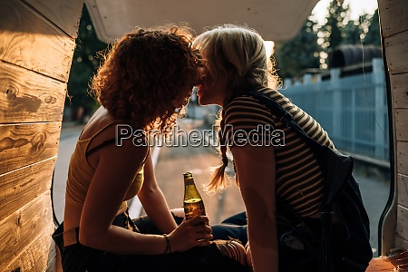 young lesbian couple sharing kiss in
