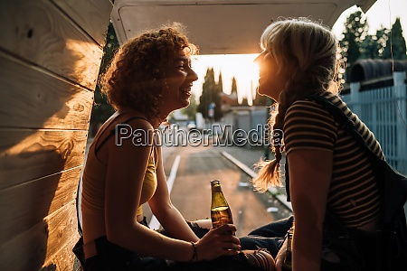 young female couple having a beer