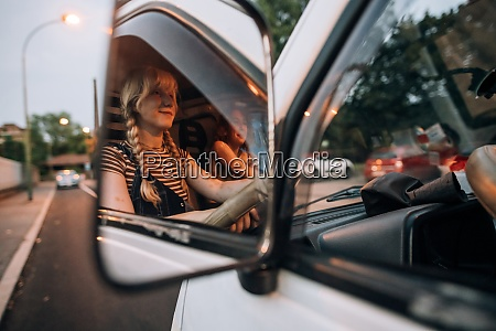 view in mirror of young women