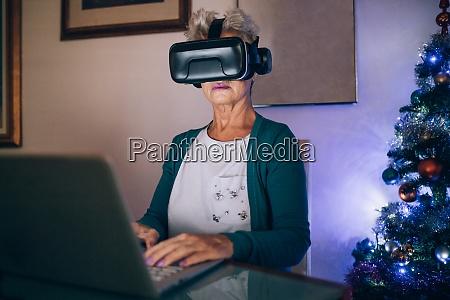 woman using virtual reality headset and