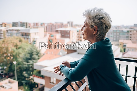woman on balcony of her apartment
