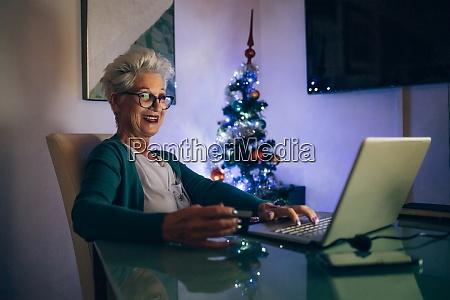 woman on laptop video call christmas