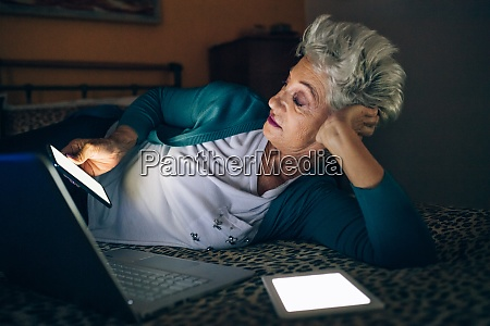 woman using different screens at night