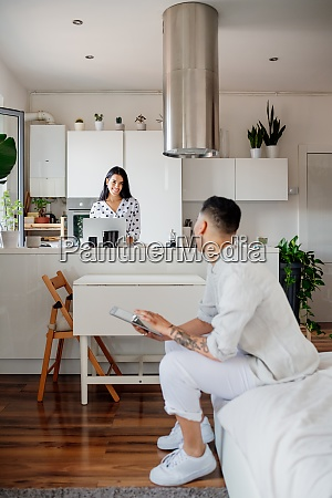 young lesbian couple in modern apartment