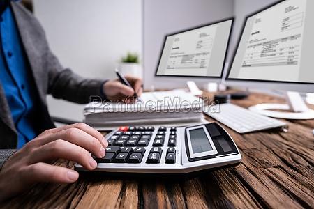 professional accountant man doing taxation