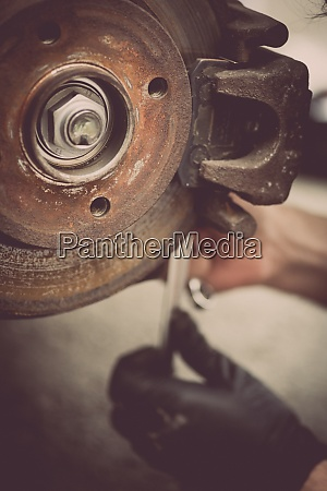 mechanic working at a car worn