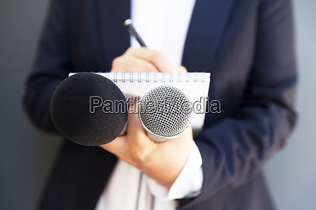 female journalist at news conference or