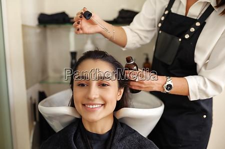 hairdresser works with hair hairdressing salon