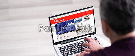 online news read on laptop computer