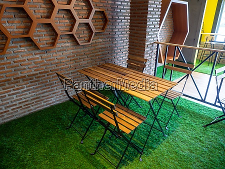 room with communal table chairs in