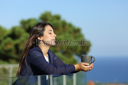 relaxed woman with closed eyes holding