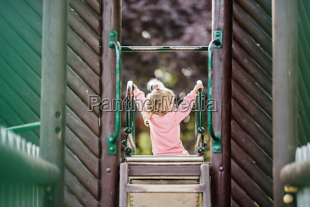 child to playgrounds having fun