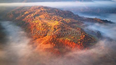 beautiful autumn mountain panorama morning thick