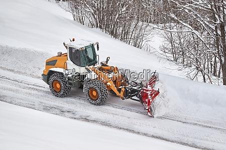 winter road clearing snowplow