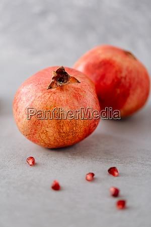 fresh juicy pomegranate fruit on neutral