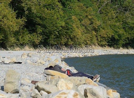 homeless people sleep on the lake