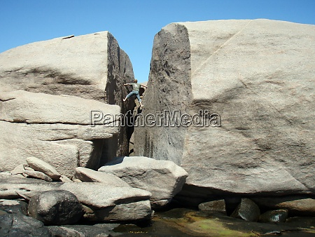 bouldering on small rock wall without
