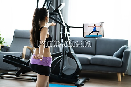 woman training using online video exercise